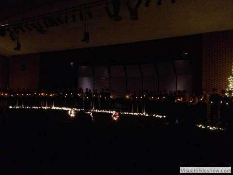 The combined choirs perform Silent Night at the Christmas Concert.